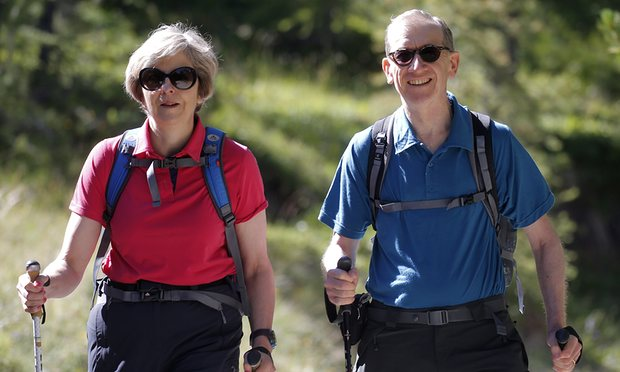 Theresa May with her husband on a walking holiday in the Swiss Alps. Photograph: WPA Pool/Getty Images